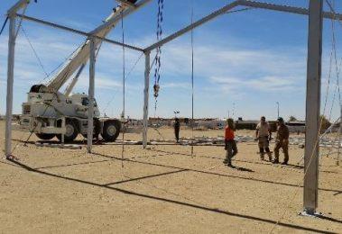 Crane assists with workshop build
